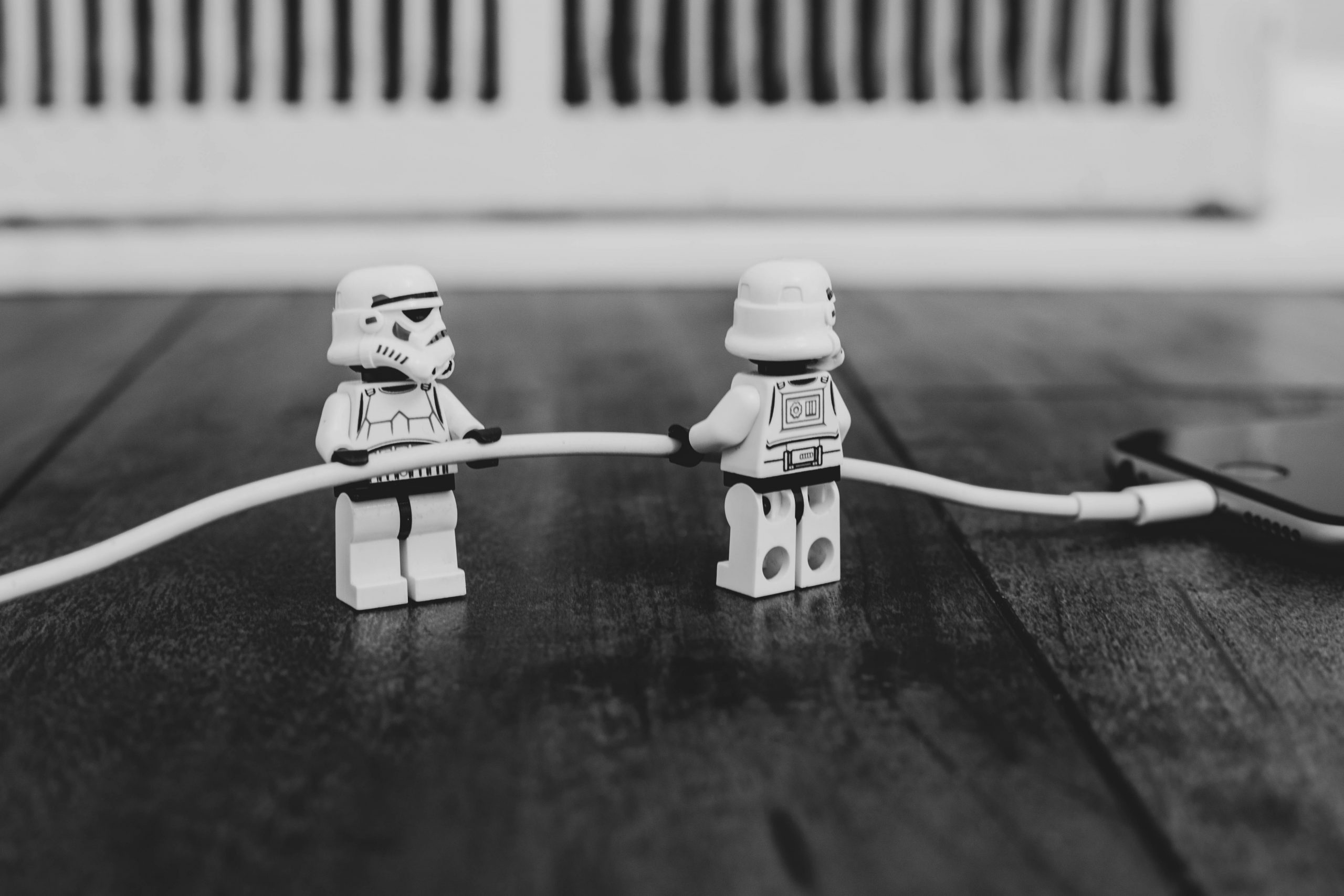 LEGO stormtrooper minifigures plugging in an iPhone cable
